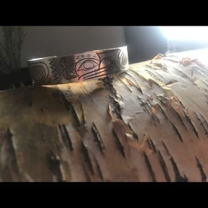 Indigenous BC carved silver eagle bracelet